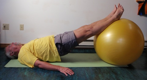 Coach John Hughes demonstrating bridging exercise for core strength training for cycling
