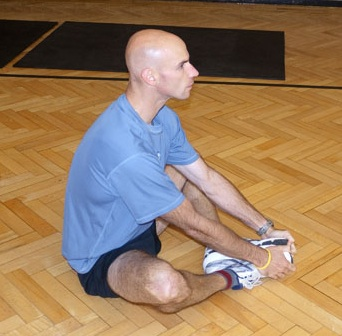Dan Kehlenbach demonstrating the groin stretch for bicycle riders