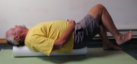 John Hughes demonstrating the roller bent leg strength exercise for core training for cyclists.