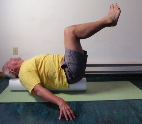 John Hughes demonstrating roller bent two leg raise exercise for core strength training for cyclists