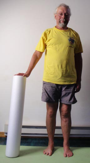John Hughes demonstrating foam roller for core strength training for cyclists