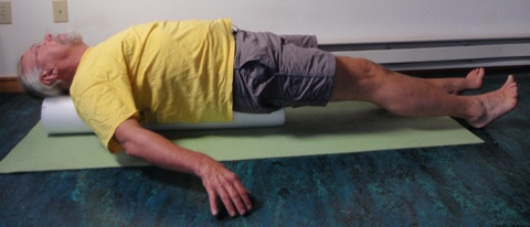 John Hughes demonstrating straight leg raise exercise for core strength training for cyclists