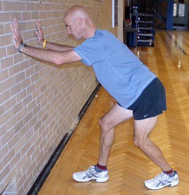 Dan Kehlenbach demonstrating the soleus stretch for bicycle riders
